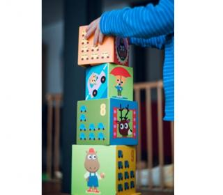 a young child stacking colorful blocks