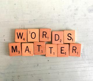 "Scrabble tiles spelling out the phrase ""words matter"""