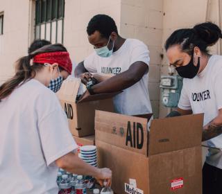 group of volunteers packing food