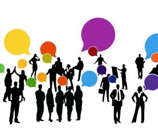 black silhouettes of business people with colorful speech bubbles