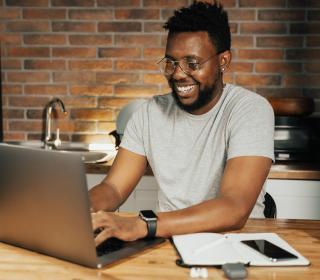 smiling grant writer at computer