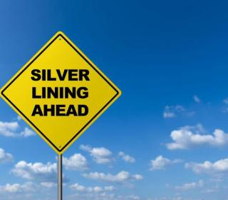 "street sign with message ""silver lining ahead"""