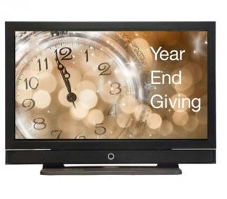 """Image of clock nearing midnight displayed on computer screen titled """"Year End Giving"""""""
